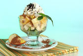 Fruit salad in a sundae dish on a blue background — Foto Stock