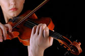 Musician playing violin on black background — Stock Photo