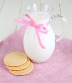 Pitcher of milk on table in room — Stock Photo