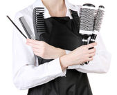 Hairdresser in uniform with working tools, isolated on white — Stock Photo
