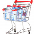Plastic bottles of water in trolley isolated on white — Stock Photo