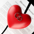 Red heart with torn Divorce decree document, on black background close-up — Stock Photo #23376668