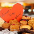 Stock Photo: Sweet cookies with valentine card on table in cafe