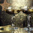 Stock Photo: Two glasses of champagne on bright background with lights