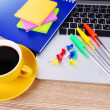 Royalty-Free Stock Photo: Laptop with stationery and cup of coffee on table