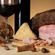 Exquisite still life of wine, cheese and meat products — Stock Photo #23377586