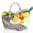 Picnic basket with fruits and bottle of wine, isolated on white — Стоковая фотография
