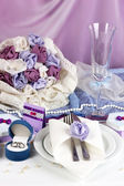 Serving fabulous wedding table in purple color on white and purple fabric background — Stock Photo