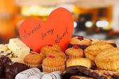 Sweet cookies with valentine card on table in cafe — Stock Photo