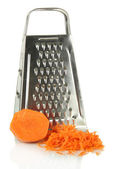 Metal grater and carrot, close up, isolated on white — Stock Photo