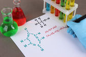 Hand scientist writing formulas — Stock Photo