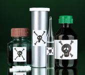 Deadly poison in bottles on black background — Foto de Stock