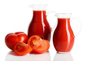 Tomato juice in pitchers isolated on white — Stok fotoğraf