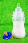 Bottle for milk and nipple on towel background — Stock Photo