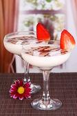 Fruit smoothies on table on window background — Stock Photo