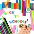 The words 'Back to School' composed of letters with various school supplies close-up isolated on white — Foto de Stock