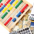 Bright wooden abacus and calculator. Conceptual photo of old and modern business — Stock Photo #23521943