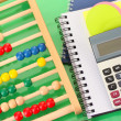 Bright wooden abacus and calculator. Conceptual photo of old and modern business — Stock Photo #23521951