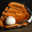 Stock Photo: Baseball glove and ball on dark background