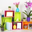 Beautiful colorful shelves with different home related objects — Stock Photo #23522805