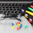 Laptop with stationery close-up — Stock Photo