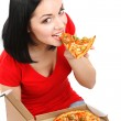 Beautiful girl eats pizza isolated on white — Stock Photo #23524089