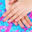 Closeup of hands of young woman with elegance manicure on bright background - Photo