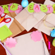 Writing letter of congratulations to Easter holidays on wooden table close-up — Stock Photo