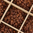 Coffee beans in wooden box close-up — Stock Photo #23525203