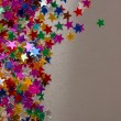 Stars confetti on gray background — Stock Photo