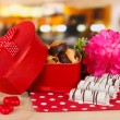Sweet cookies in gift box on table in cafe — Stock Photo #23525267