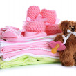 Pile of baby clothes isolated on white — Stock Photo #23525643