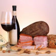 Exquisite still life of wine, cheese and meat products — Stock Photo #23525873