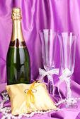 Wedding accessories on purple cloth background — Stock Photo