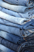 Many jeans stacked in a pile closeup — Stock Photo
