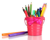 Colorful pencils and felt-tip pens in pink pail isolated on white — Foto de Stock