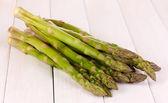 Fresh asparagus on white wooden table background — Stock Photo