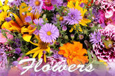 Beautiful bouquet of bright flowers close-up and word flowers — Stock Photo
