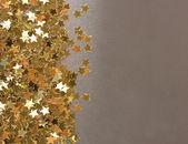 Stars confetti on gray background — Stock Photo