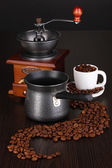 Coffee maker and coffee mill on brown table — Stock Photo