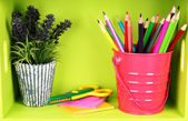 Colorful pencils in pail on shelf on wooden background — Stock Photo