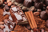 Composition of chocolate sweets, cocoa and spices — Stock Photo
