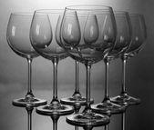 Empty wine glasses arranged on grey background — Stock Photo