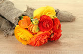 Ranunculus (persian buttercups) on wooden background — Stock Photo