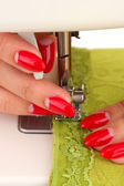 Hand sewing on machine — Stock Photo