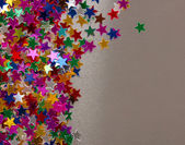 Stars confetti on gray background — Стоковое фото