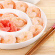 Prawns on plate with chopsticks and sauce — Stock Photo #23591937