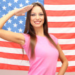 Royalty-Free Stock Photo: Young woman with American flag