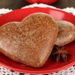 Chocolate cookies in form of heart on wooden table close-up — Stock Photo