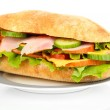 Fresh and tasty sandwich with ham and vegetables isolated on white — Stock Photo #23592601
